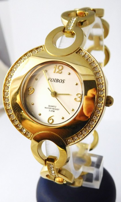 Šperkové dámské hodinky s kamínky po obvodu Foibos 24722 - zlaté ... 16831088b1b